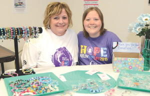 Carol Kennedy, left, and her daughter, Kelly Sidorick, are selling jewelry and keychains at Always On Call in Leominster, to raise money for cancer research. SENTINEL & ENTERPRISE / Ashley Green